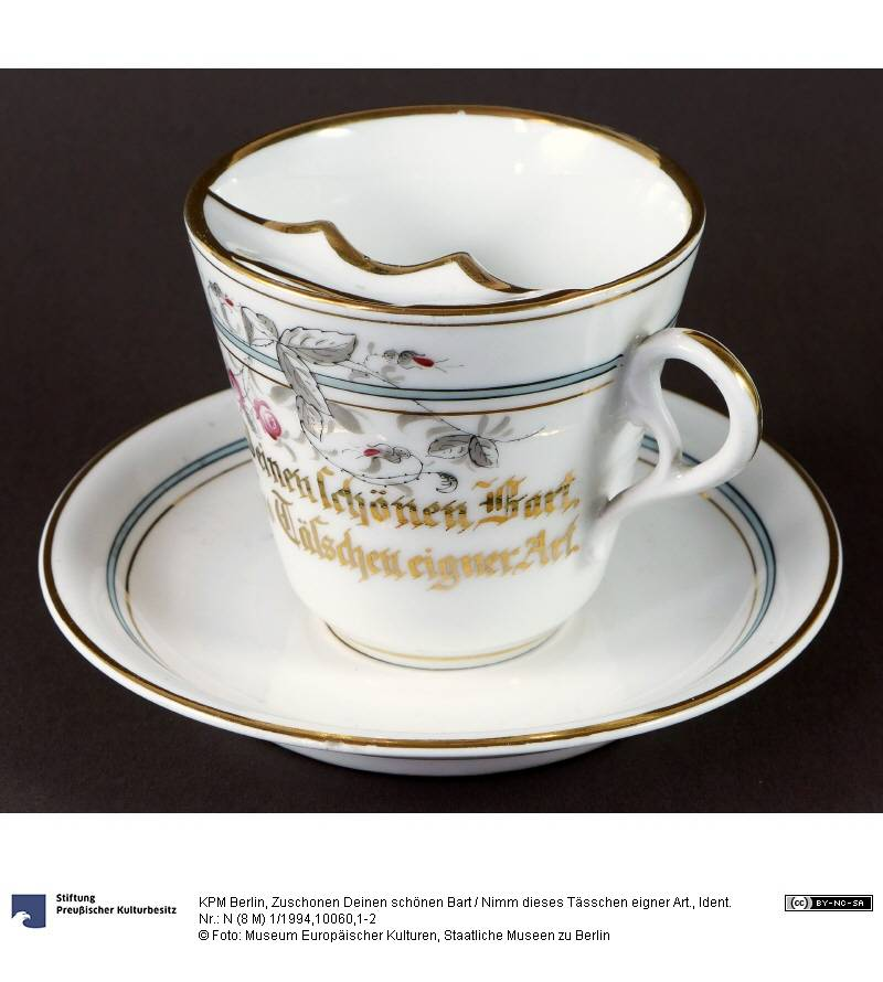 """Bearded cup"" (ca. 1890) Inscription: To treat your handsome beard with care / take this cup of its own kind.  Museum of European Cultures, National Museums in Berlin (CC BY-NC-SA 3.0 Germany)"