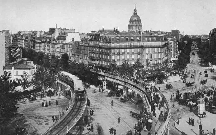 Fahrbare Gehsteige neben der Bahnlinie in Paris, 1900, aus: Julius Meier-Graefe, Die Weltausstellung in Paris 1900 / Universitätsbibliothek Heidelberg, CC BY 3.0 DE
